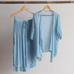 Lightweight Summer cardigan top. 'Any-which-way' semi-sheer fabric true to size buttoned cover-up. Sizes 8-22. Chambray.