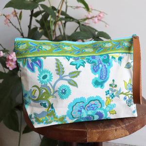Zippered clutch handbag, a versatile clutch in a floral design perfect for cosmetics, phones or wallets. Generously sized, lightweight with a washable lining.