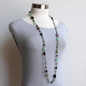 Hand knotted from various glass beads and pieces of worn seaglass in beautiful shades of jade and emerald greens. Full length measures 110cm around.