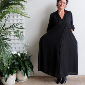 Apres Spa Kaftan Dress in classic black. Front view with pockets.