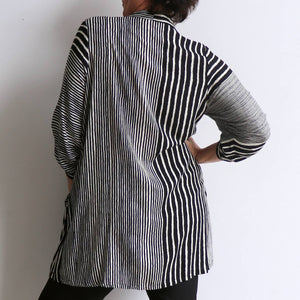 Apres Spa Kaftan Tunic Top in a modern black stripe. Back view.