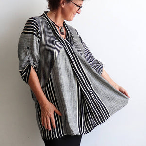 Apres Spa Kaftan Tunic Top in a modern black stripe. Side view.