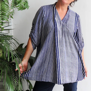 Apres Spa women's tunic top with striped pattern. One-size fit with mid-length sleeve and button feature kaftan top. Made with easy-care rayon fabric. Navy.