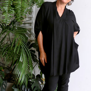 Apres Spa Kaftan Tunic Top in a classic black. Side view.