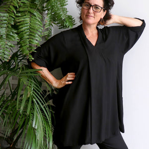 Apres Spa Kaftan Tunic Top in a classic black. Front view.