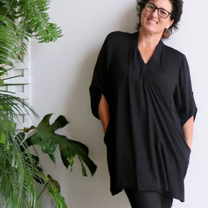 Apres Spa Kaftan Tunic Top in a classic black. Two deep pockets.