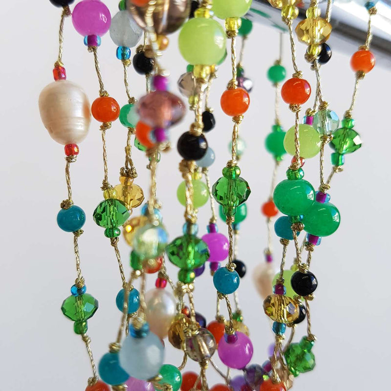 Ariel Glass and Pearl Necklace Rainbow glass beads + gold threading.