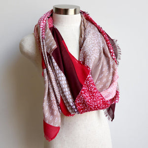 Autumn Skies Scarf manufactured from a soft and light cotton/poly.  Wonderfully oversized and measuring 180cm x 90cm. Cherry Red.