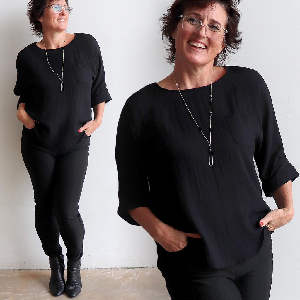 Avoca Blouse with 3/4 sleeve made in linen blend fabric with a button cuff and pleat detail. . Black