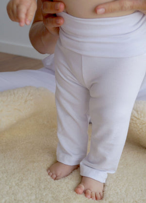 Girls and boys full length legging tights with wide, yoga foldover waistband. Comfy fit and great layer. Sizes to fit newborns, toddlers, kids and tweens up to 10 years old. Ethically handmade with soft, stretch bamboo spandex. White