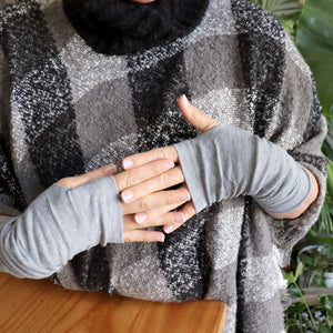 Finger-less winter warmers made with a stretchy cotton knit. Long mitts that are great for staying warm while keeping fingers free. Earl Grey,