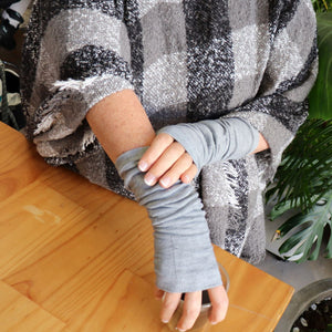 Finger-less winter warmers made with a stretchy cotton knit. Long mitts that are great for staying warm while keeping fingers free. Earl Grey.