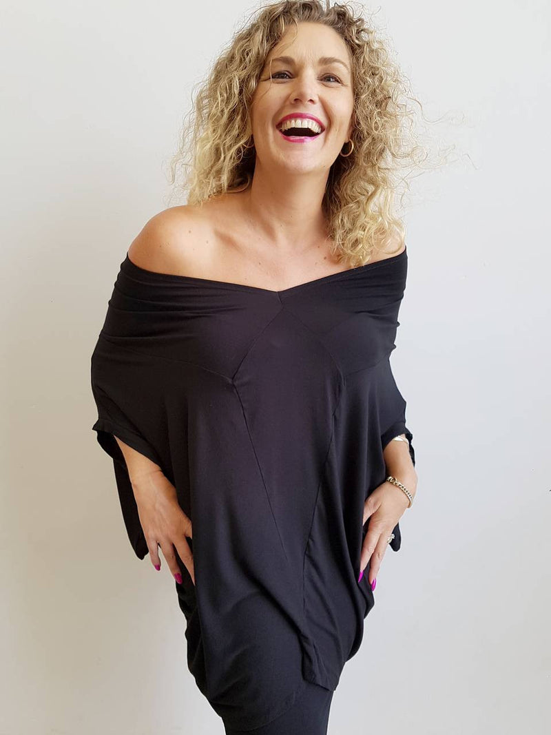 Plus size jersey kaftan top can be worn as a mini dress. Draping stretch fabric give a luxe loungewear style. Black.