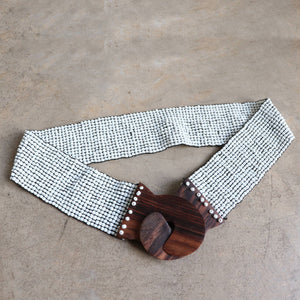 Full beading on elastic weave women's belt fitting sizes 10 to 18. Chic coconut wood slot buckle.