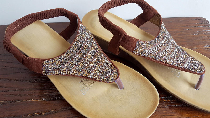 Soft suede-feel, wedge heel summer sandal with gold + pewter glass beading + elastic pull-on ankle strap. Brown.