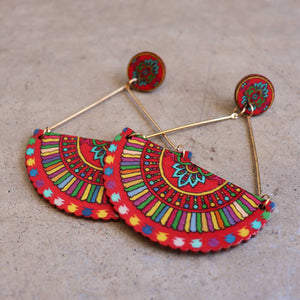 Carnivale Earrings in light wood with a festive design. Available in turquoise blue and red.