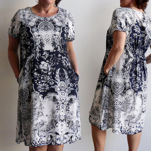 The Charlie Shift dress is a smart-casual, short sleeve shift dress in an elegant navy blue print and below-the-knee hemline.