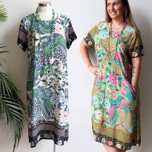 Smart, short sleeve women's dress with convenient side pockets. This design has a below the knee hemline with slight elastic shaper at the back to flatter the waist in a vibrant peony + peacock print. Sizes 10/12 to 20/22.