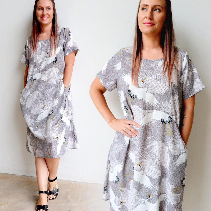 Loose fitting summer shift dress with short sleeves, below-the-knee hemline and pockets! Plus sizes available.