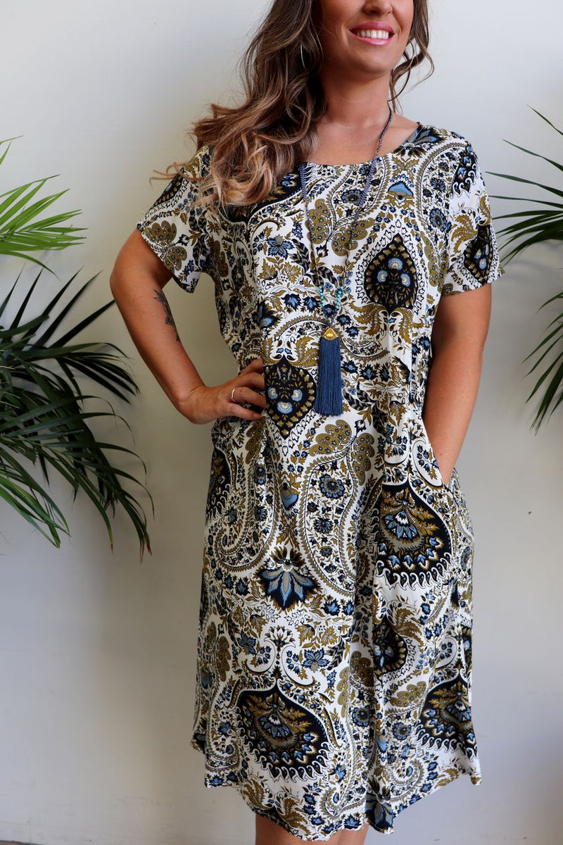 Loose fitting, short sleeve summer shift dress with pockets and below the knee hemline in sizes to plus size. Exotic paisley print.