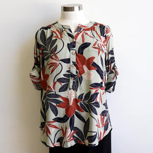 Classic cut women's summer top, features 3/4 cuffed sleeves with button fastening. Designed in a brilliant floral print in a cotton-feel rayon. Available in sizes 8-20. Rust.