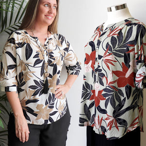 Classic cut women's summer top, features 3/4 cuffed sleeves with button fastening. Designed in a brilliant floral print in a cotton-feel rayon. Available in sizes 8-20.