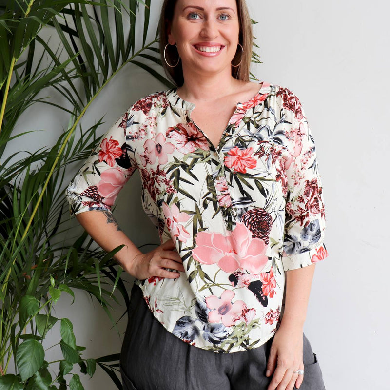 Chelsea Blouse - Floriade featuring three-quarter cuffed sleeves, with optional button back fastening.  A light scooped hem Summer top made with 100% rayon in a dazzling floral print. Available in sizes 8 to 20.