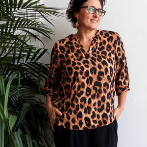 Chloe Blouse in Animal Print is a classic women's shirt. Leopard brown. Front view.