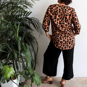 Chloe Blouse in Animal Print is a classic women's shirt. Leopard brown. Back View.