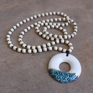 Handmade necklace featuring a cloud, circle or tear-drop shaped ceramic pendant. Circle - White.