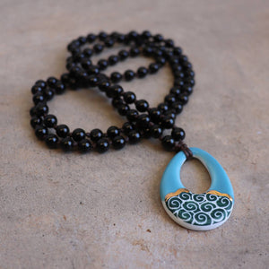 Handmade necklace featuring a cloud, circle or tear-drop shaped ceramic pendant. Tear Drop - Black.