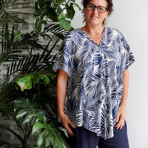 Coconut Summer short sleeved women's blouse in a palm print. Made from 100% rayon in sizes 8-18.