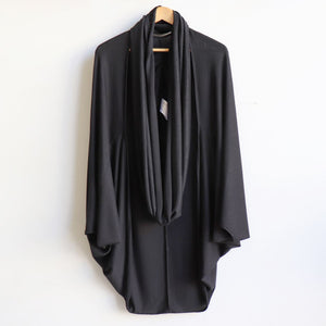 One-size open cardi top made with a stretch knit fabric . Designed with a luxe feel and a generous cut to fit all sizes. Ethically hand cut + sewn. Black.