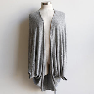 One-size open cardi top made with a stretch knit fabric . Designed with a luxe feel and a generous cut to fit all sizes. Ethically hand cut + sewn. Silver.