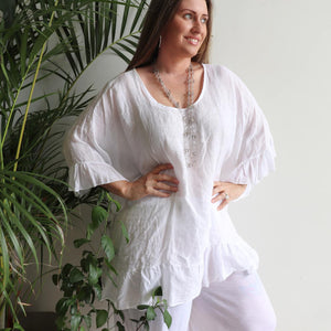Luxurious 100% Italian Linen kaftan style top with feminine floaty ruffles. Great for the beach or any casual occasion. White.