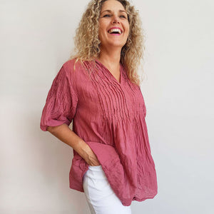 Women's 100% all natural cotton blouse top with bodice pintucking. Summer shirt with longer length has elbow length sleeves with elastic cuff and subtle v-neck.