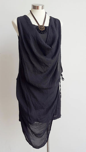 Lightly textured soft + floaty cowl neck tunic dress with draping middle panel that ties on one side. Easy, low-maintanance cotton blend sleeveless summer dress perfect for holidays in the sun. Sizes 8 > 20 available. Black.