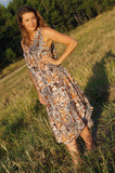 Lightweight rayon Summer dress with a scallop hem and scoop neck. Animal print, brown. Free-size, fits sizes 10 - 18 plus.