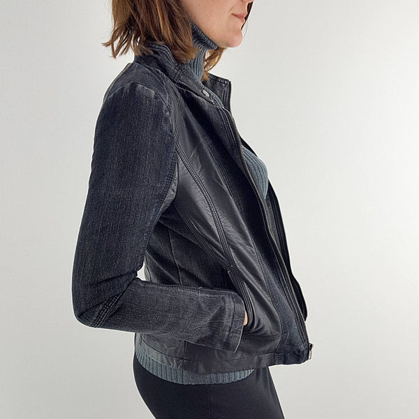 Dark denim jacket in classic biker style with zipper front.