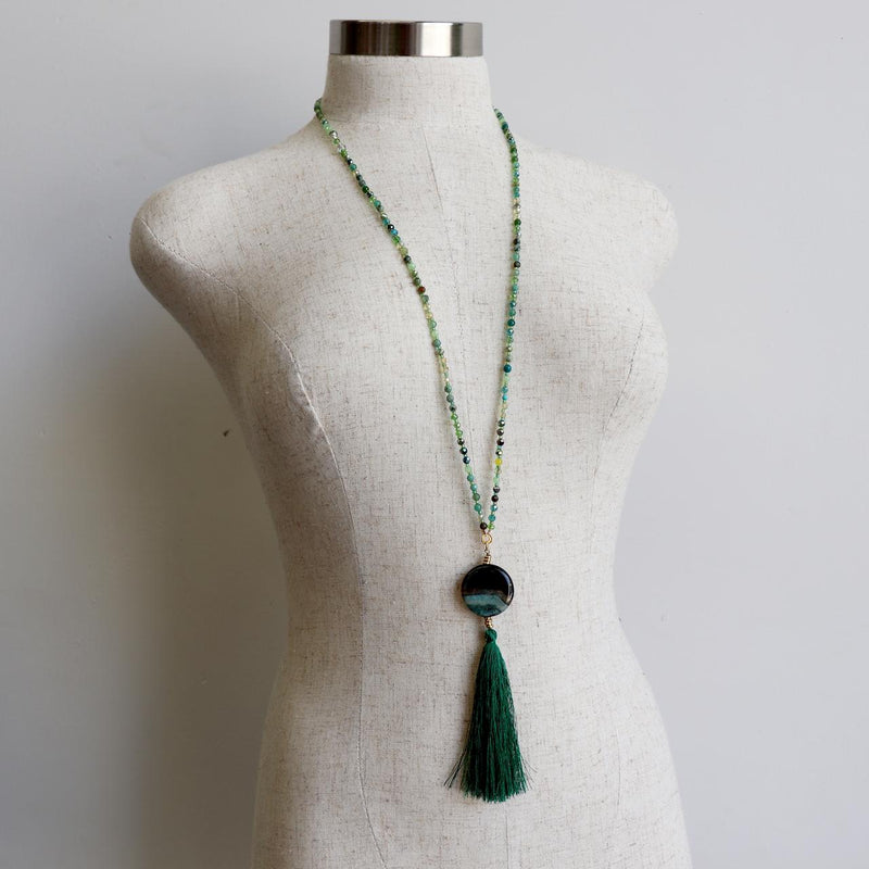 Delta Necklace is handmade with cut glass beads and a semi precious stone pendant with tassel.  Forest Green.