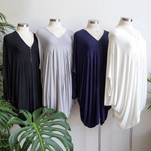 Plus size jersey kaftan top can be worn as a mini dress. Draping stretch fabric give a luxe lounge-wear style.