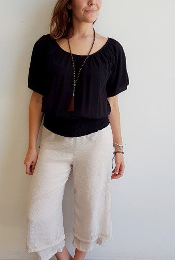 Light + floaty ruche round neck Spanish style summer blouse with smocked waistband. Black.