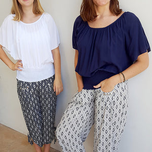 Light + floaty ruche round neck Spanish style summer blouse with smocked waistband. Navy + white.