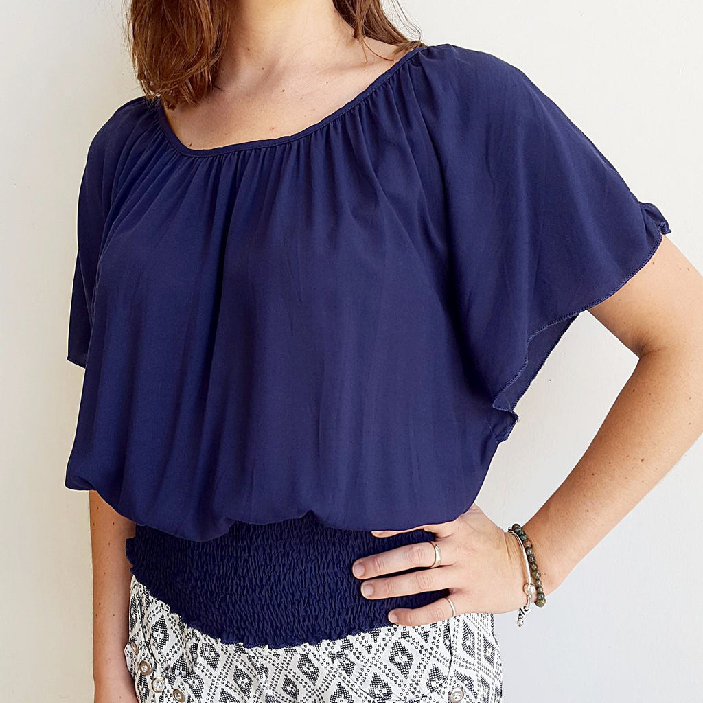 Light + floaty ruche round neck Spanish style summer blouse with smocked waistband. Navy.