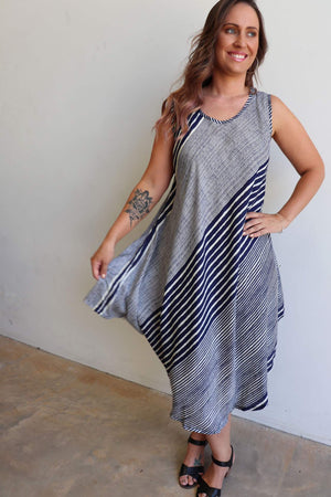 Free flowing summer dress in navy blue stripe fits up to plus size. Perfect holiday wear.