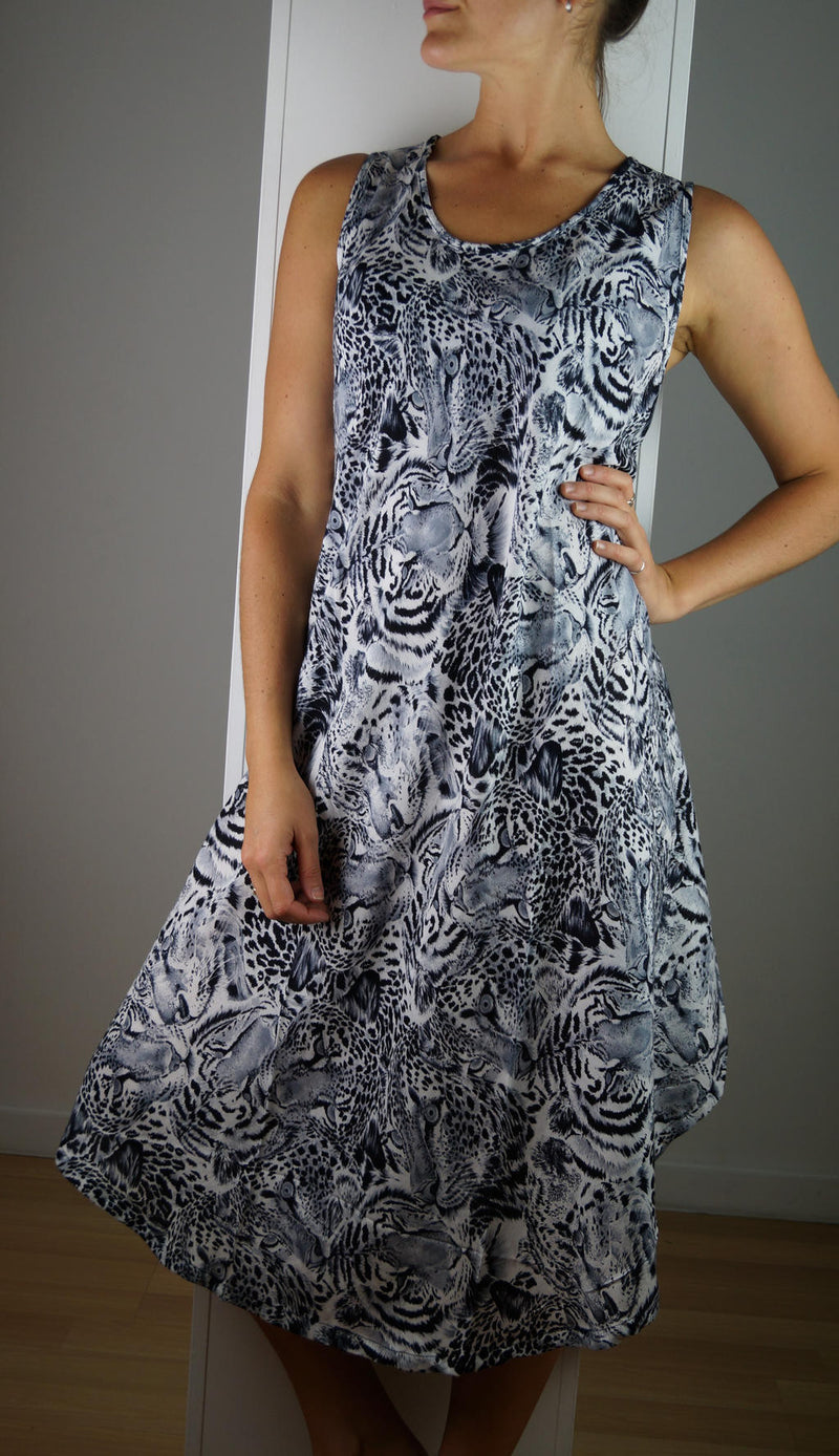 Lightweight rayon Summer dress with a scallop hem and scoop neck. Animal print, black. Free-size, fits sizes 10 - 18 plus.