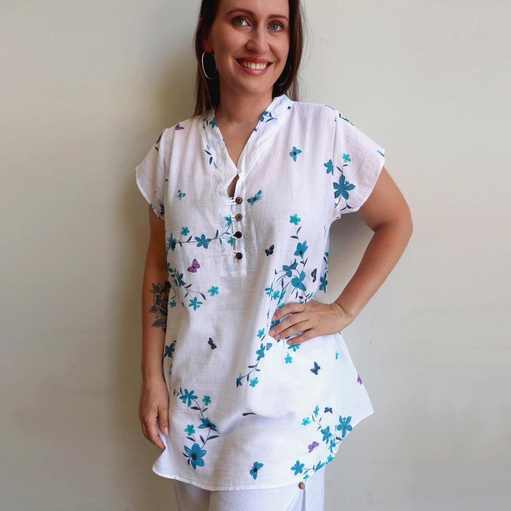 Easy fit one-size lightweight cotton tunic top with cap sleeve. Blue.
