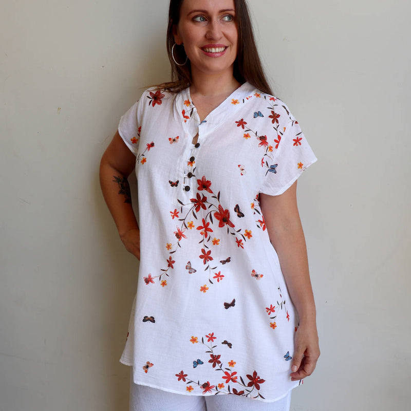 Easy fit one-size lightweight cotton tunic top with cap sleeve.