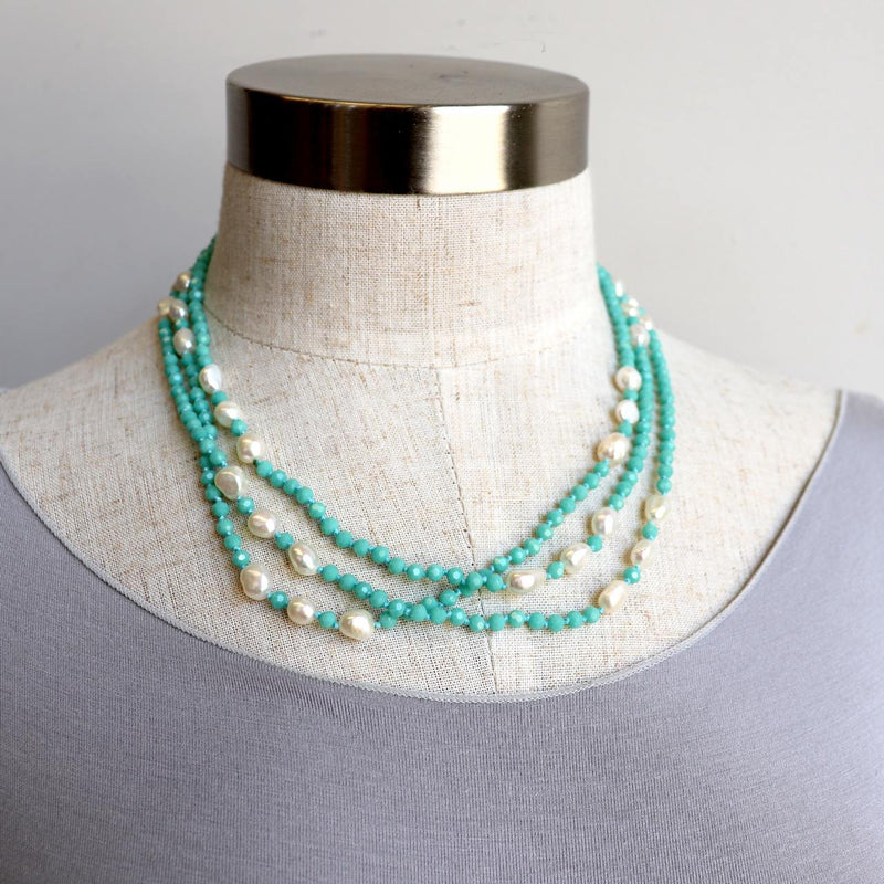 Fine, long-stranded necklace made with freshwater baroque pearls and fine, faceted glass beads. Measures 150cm around.