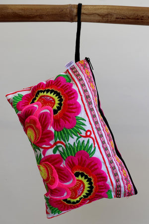 Zip-up embroidery fabric clutch bag or cosmetic bag. Multi-colour neon floral patterns.